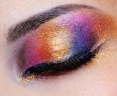 Closed eye with multicoloured eyeshadow — Stock Photo