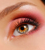 Eye with ceremonial bright make-up — Stock Photo