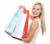 Beauty blond woman present purchases — Stock Photo