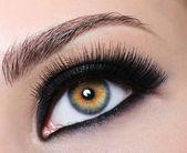Female eye with black long eyelashes — Stock Photo