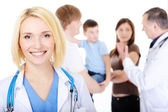 Doctor with the young family — Stock Photo