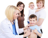 Little boy on medical reception — Stock Photo