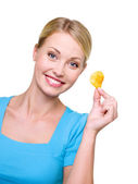 Beautiful girl with one chip in hand — Stock Photo