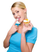 Woman eats sweet white cream — Stok fotoğraf
