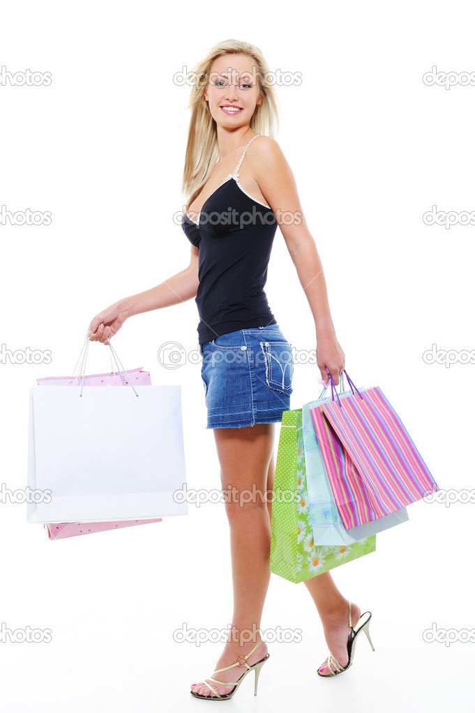 Walking young beautiful woman after shopping - white background — Stock Photo #1512984