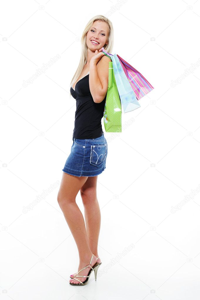Full-length portrait of beautiful woman with bags of purchases after shopping — Stock Photo #1512987
