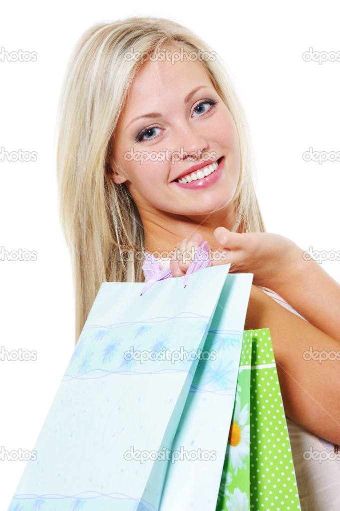 Portrait of beautiful young woman with purchases from shop - isolated — Stock Photo #1512990