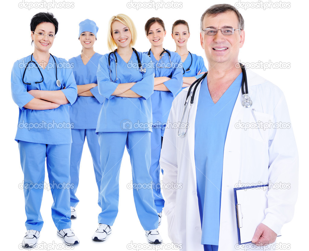 The mature experienced doctor with his colleagues at the background — Stock Photo #1514559