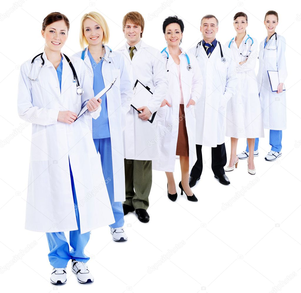 Line of group of happy doctors in hospital gowns- isolated on white — Foto de Stock   #1514584