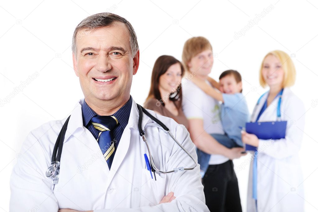 Laughing mature male doctor and the young happy family with little son