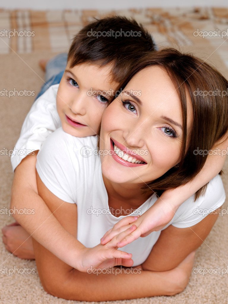 smiling mother with he son stock photo valuavitaly. Black Bedroom Furniture Sets. Home Design Ideas