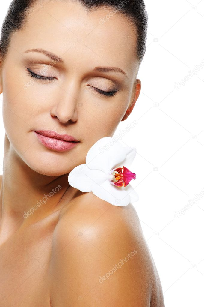 Close-up portrait of a beautiful woman with flower near her face  Stock Photo #1519377