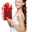 Woman with a christmas present — Stock Photo #1525700