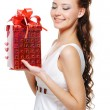Woman with a christmas present — Stock Photo