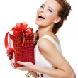 Laughing girl holding the box present — Stock Photo