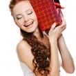 Cute girl holding present — Stock Photo