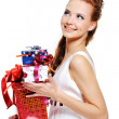 Female holding the present and looking — Stock Photo