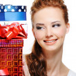 Happiness of a girl with presents — Stock Photo #1525749