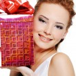 Attractive female with present - Stockfoto