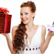 Surprised woman choosing presents — Stock Photo