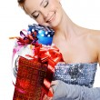 Happy girl holding christmas  presents — Stock Photo #1525803