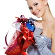 Woman with christmas present boxes — Stock Photo
