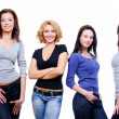 Four sexy young happy girls — Stockfoto