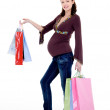 Pregnant woman with purchases — Stock Photo #1526413