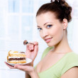 Woman with a sweet cake — Stock Photo