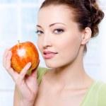 Beautiful woman with apple — Stock Photo #1526856