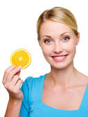 Woman with a cantle orange — Stock Photo