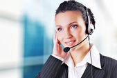Woman wearing headset — Stockfoto