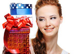 Happiness of a girl with presents — Stock Photo