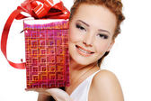 Attractive female with present — Stock Photo
