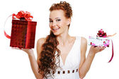 Surprised woman choosing presents — Stock Photo