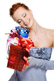 Happy girl holding christmas presents — Stock Photo