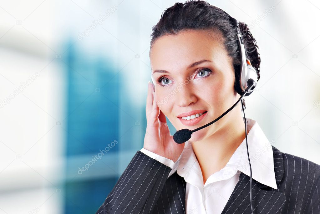 Woman wearing headset in office; could be receptionist — Stok fotoğraf #1520080