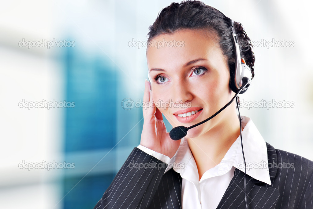 Woman wearing headset in office; could be receptionist  Stockfoto #1520080