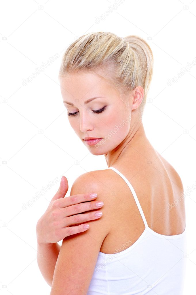 Woman care massaging her shoulder over white background — Stock Photo #1520155
