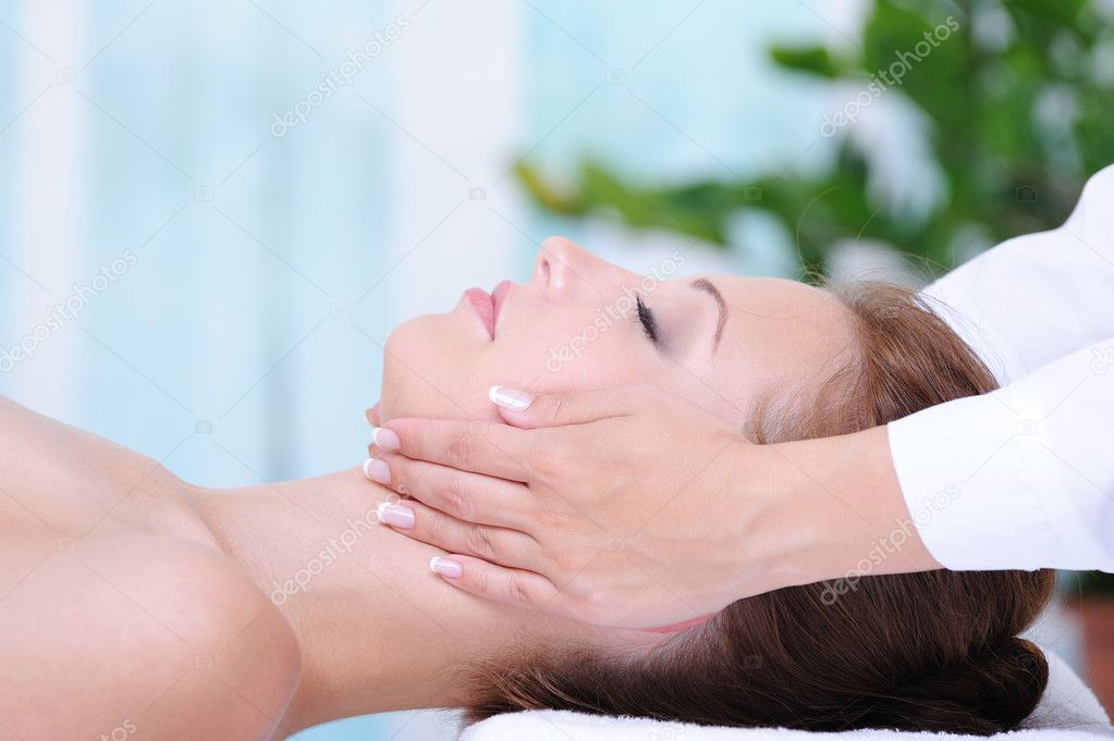 Female face massage in the beauty salon - profile close-up  Stock Photo #1520187
