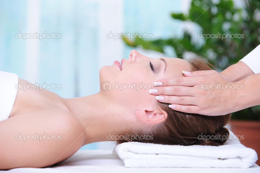 Beautiful woman in the beauty salon getting a face massage  Stock Photo #1520189