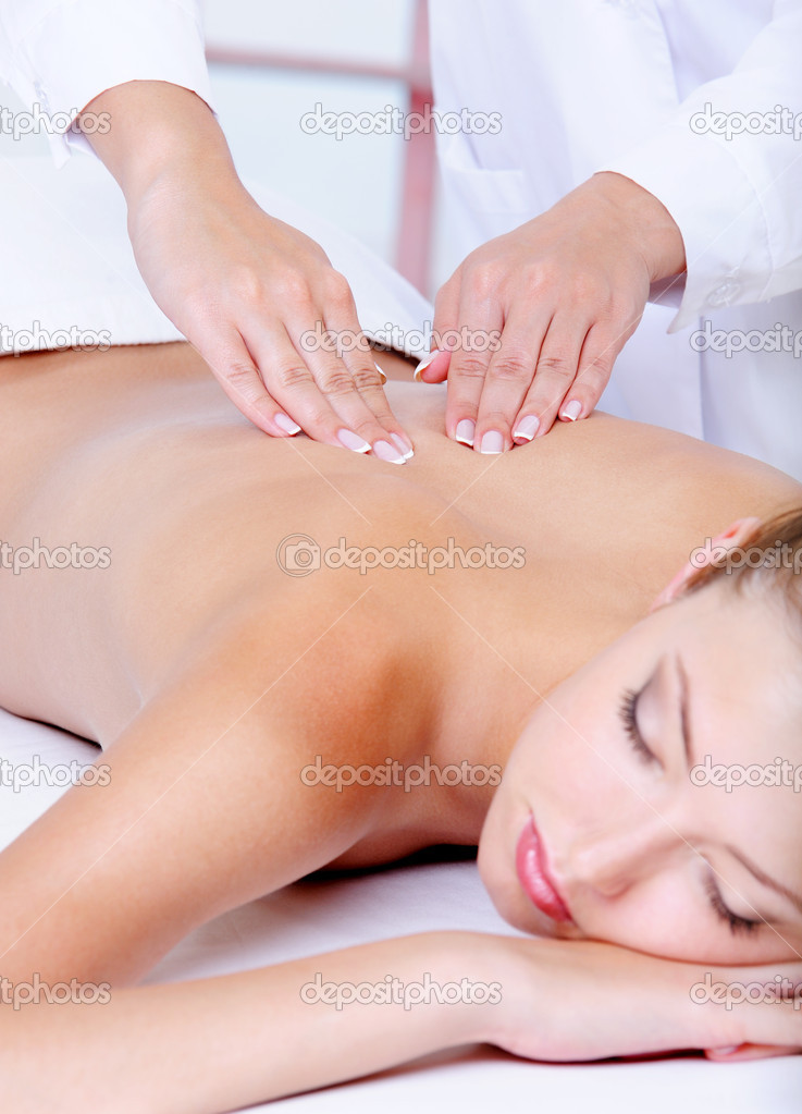 Back massage for the young pretty woman - close-up portrait — Stock Photo #1520235
