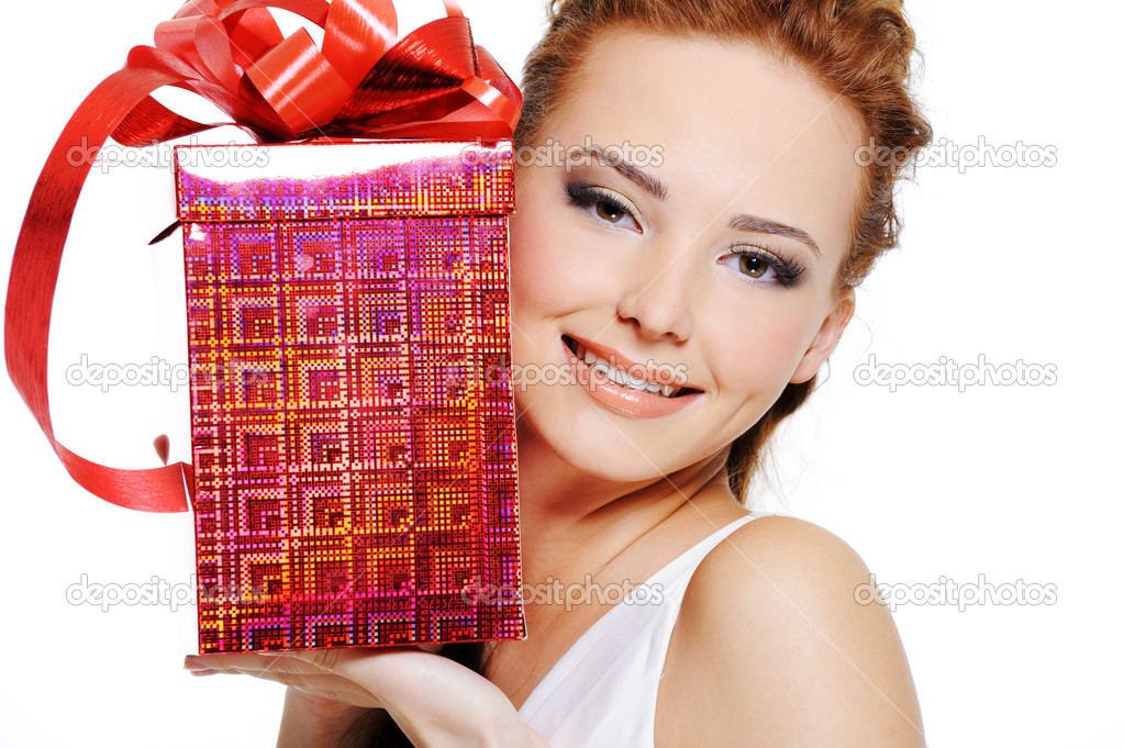 Attractive female with present near face over white background  Stock Photo #1525761