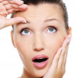 Pretty woman squeeze skin on forehead — Stock Photo #1537585