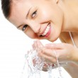 Happy beautiful woman wash her face — Stock Photo