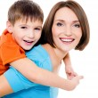 Stock Photo: Appy cheerful mother with little son