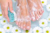 Woman washes and cleans her foot — Stock Photo