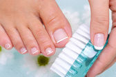 Woman washes and cleans toenails — Stock Photo