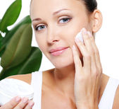 Woman holding moisturizer cream — Stock Photo