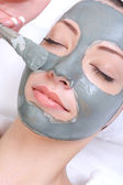 Cosmetic procedure with clay — Stock Photo